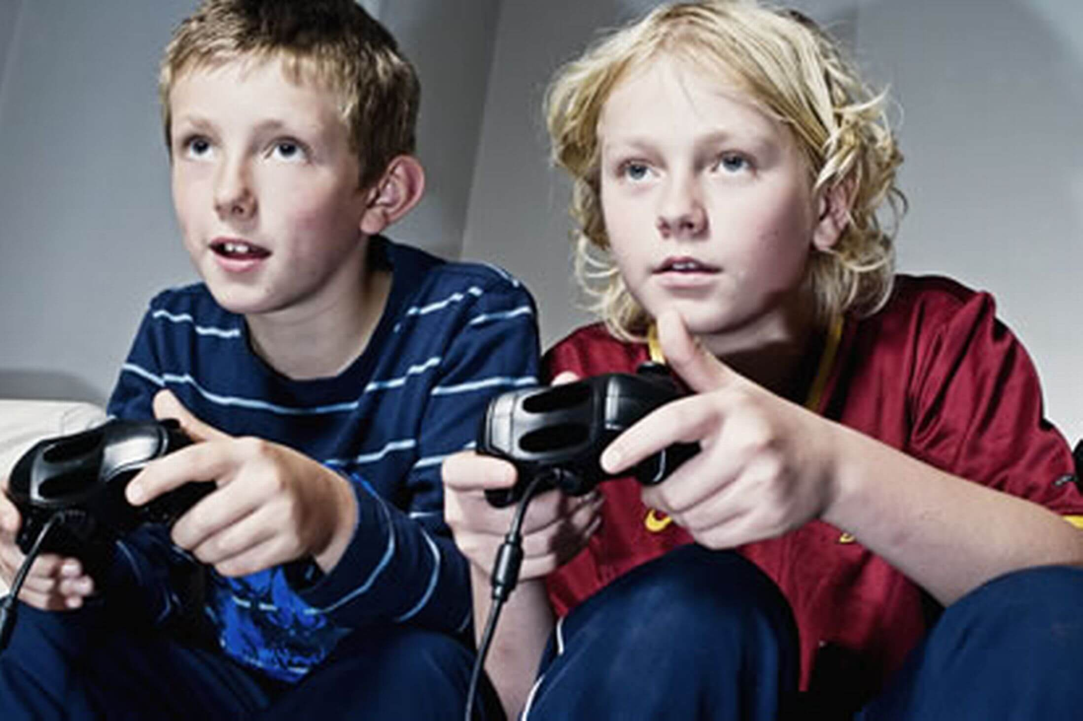 children-playing-on-computer-games-console-image-1-5212007822